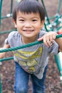 boy piaying on ropes