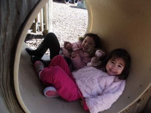 toddler girls in tunnel