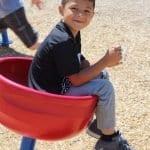 school age boy on playground