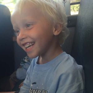 smiling boy on school bus