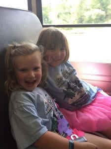 two girls on school bus