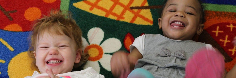 Apple Ridge toddler girls on rug