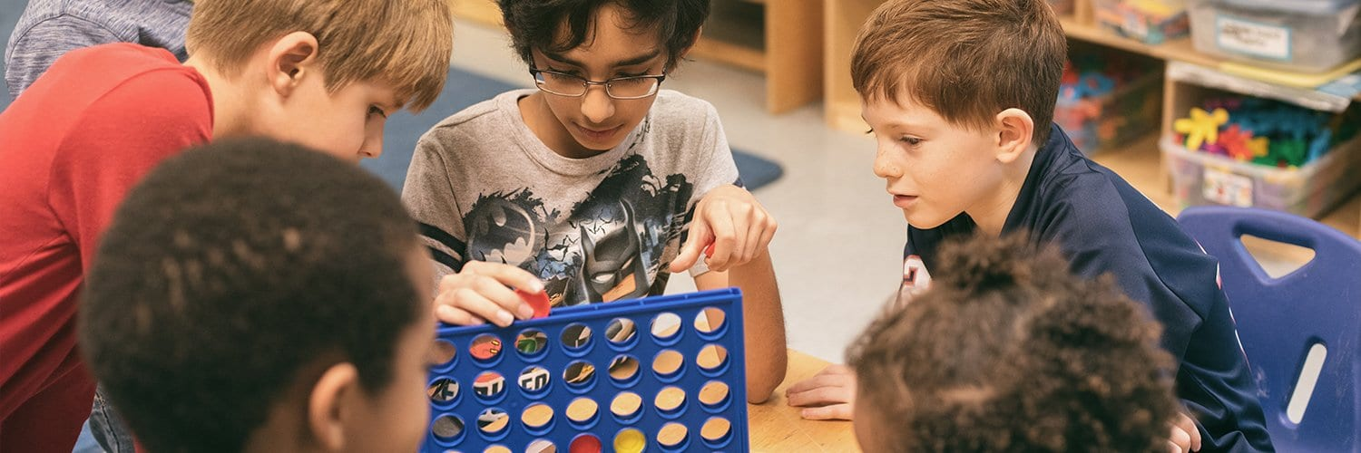 boys playing connect four