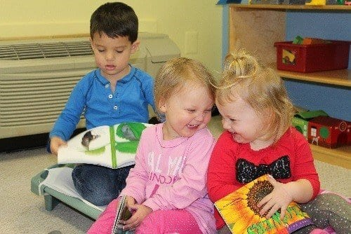 Toddlers-enjoy-reading-at-our-childcare-center