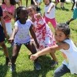 children exercising outside
