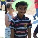 smiling boy striped shirt