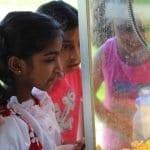 girls at popcorn machine
