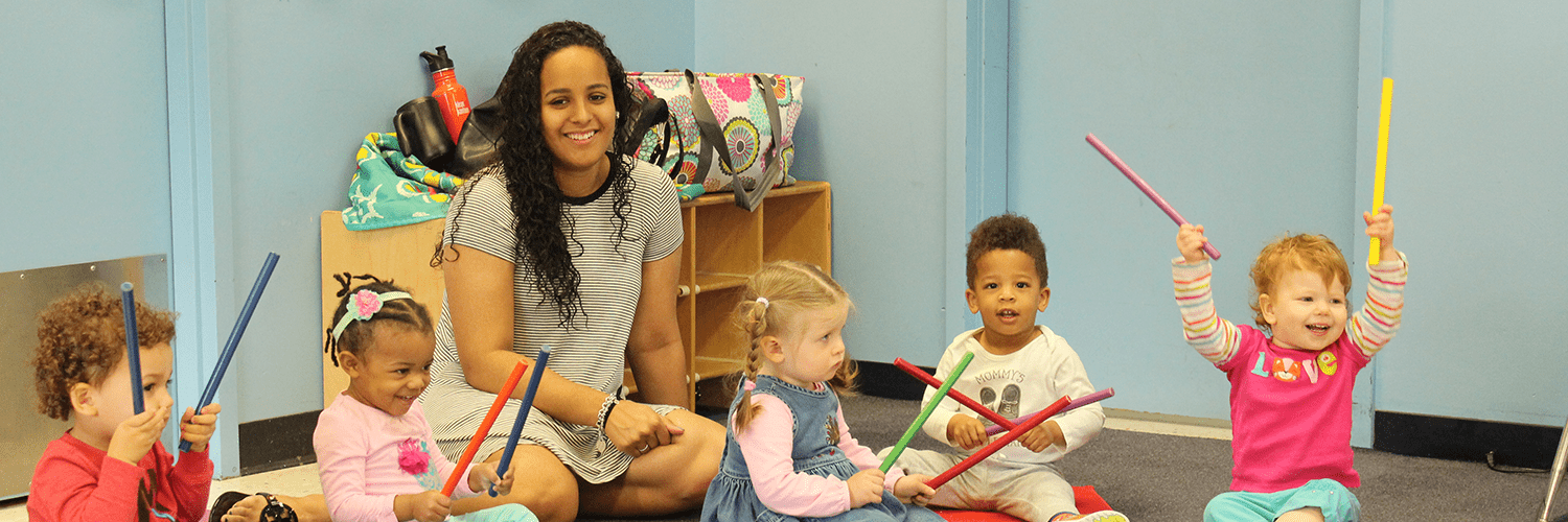 toddlers with drumsticks in music class
