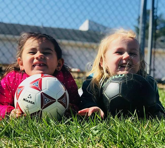 girls playing with a soccer ball