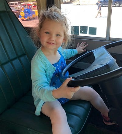 toddler driving a bus