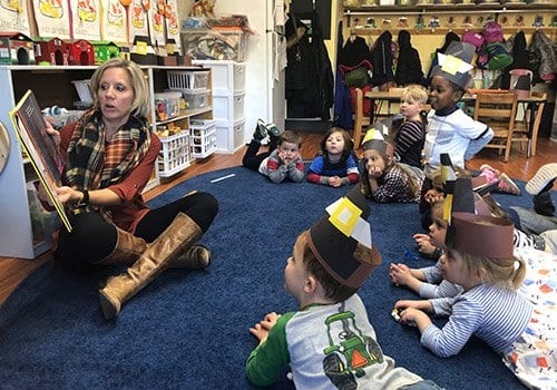 Three year old class at storytime at our preschool