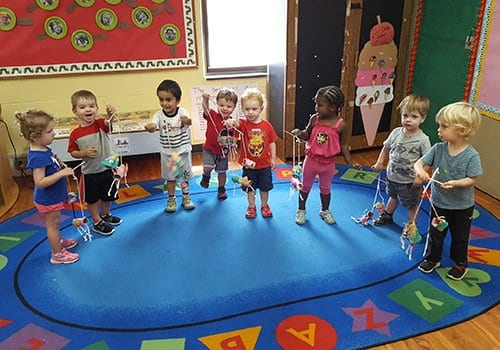 Toddlers playing with puppets in our preschool classroom