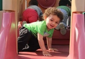 Tow year old playing in the playground at our daycare