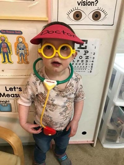 Toddler dressed up as a doctor at our daycare center