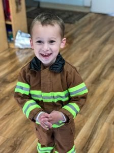 toddler dress up as a firefighter at our daycare center