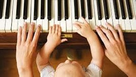 baby playing with a piano