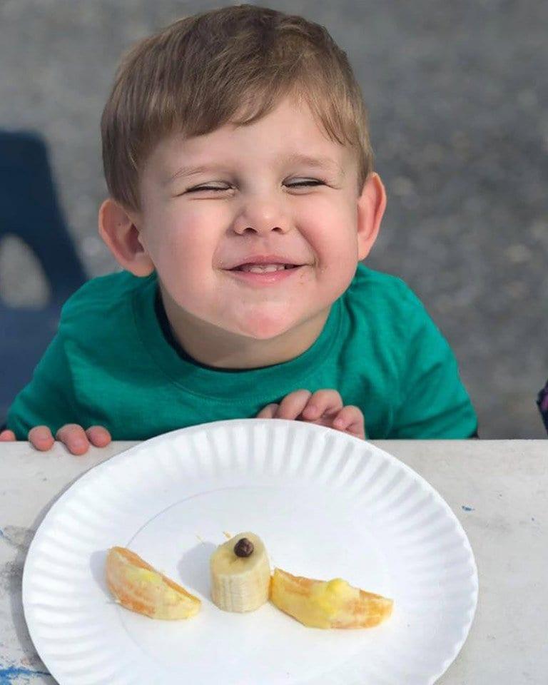 boy eating fruit at preschool