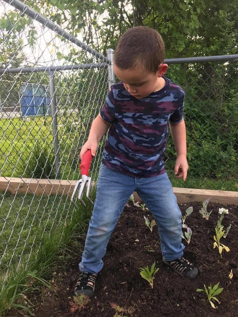 boy gardening at preschool