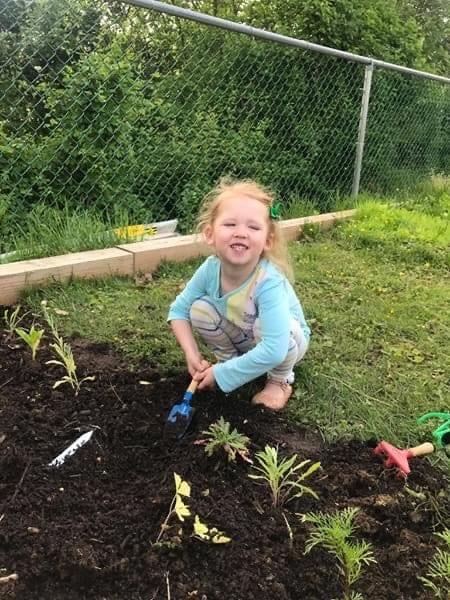 boy preparing soil for gardening