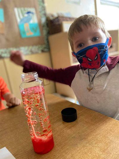 boy with spiderman mask on at preschool