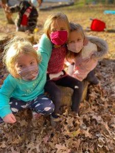 masked children playing outside resized