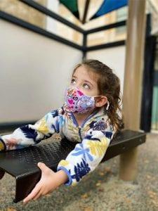 masked girl on bench resized