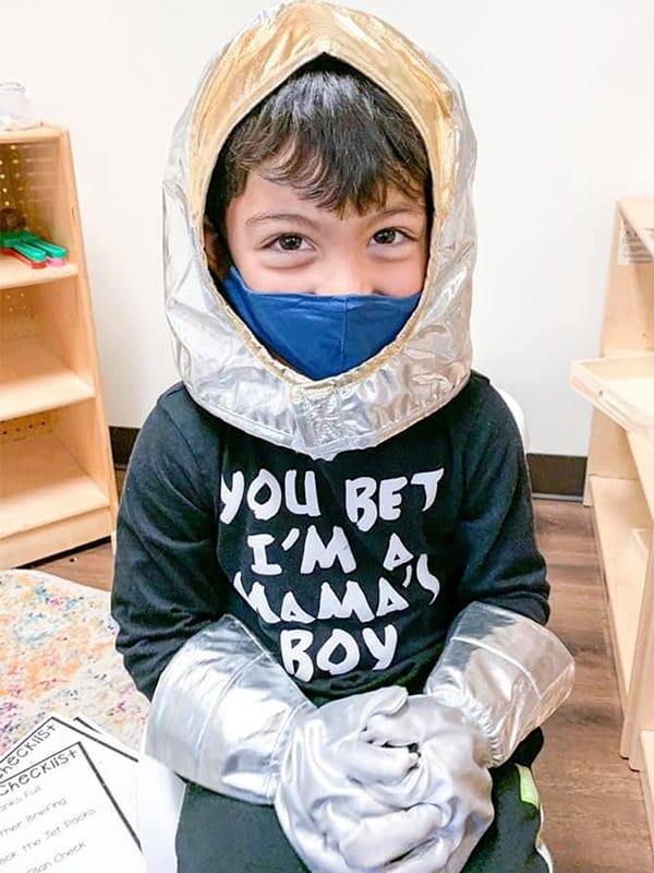 Masked astronaut boy