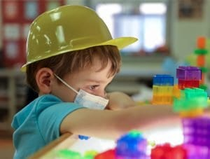 boy playing with light blocks at preschool