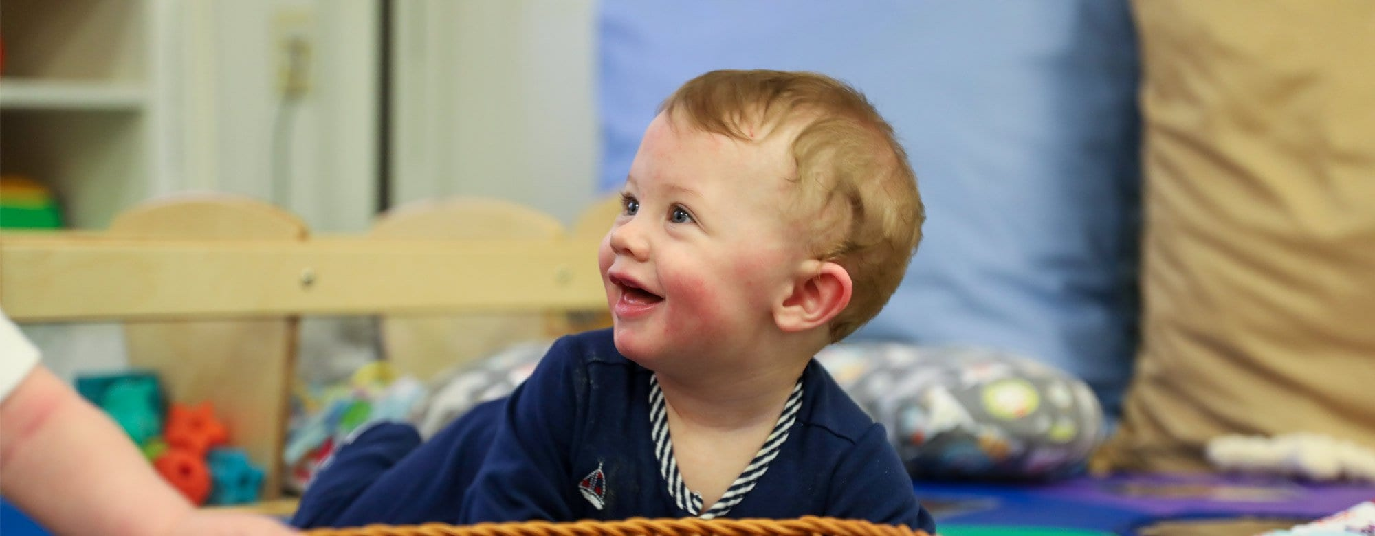 infant program header 3 baby playing at preschool